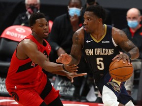 New Orleans Pelicans guard Eric Bledsoe (5) moves to the basket as Toronto Raptors guard Kyle Lowry (7) defends during the second half at Amalie Arena.