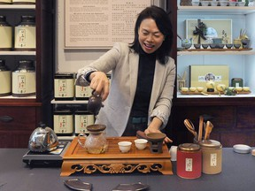 "Olivia Chan with with her special ""Founder's Blend"" tea, a blend created by a tea farmer in China who came out of retirement in October to help people through the difficult times of COVID-19."