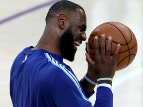 LeBron James of the Los Angeles Lakers laughs prior to a game against the San Antonio Spurs at Staples Center on Jan. 7, 2021 in Los Angeles, Calif.