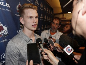 Bowen Byram, the Colorado Avalanche's first-round selection in the NHL Draft and fourth pick overall, talks with reporters during a news conference to introduce the Avalanche's selections to the local media in the team's locker-room on June 25, 2019, in Denver.