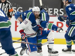 Vancouver Canucks left wing Tanner Pearson (70) gets tangled up with Montreal Canadiens defenseman Jeff Petry (26) during first period NHL action in Vancouver, Wednesday, Jan. 20, 2021.