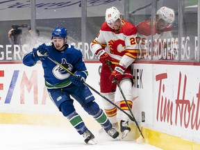 Quinn Hughes and the Vancouver Canucks took it to Joakim Nordstrom and the Calgary Flames in the first period but failed to score despite a 20-shot outburst. Still, they managed a hard-fought 3-1 victory to break a six-game losing streak.