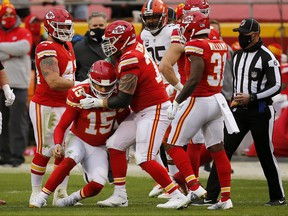 Chiefs quarterback Patrick Mahomes is assisted to his feet by offensive tackle Mike Remmers after a sack. Remmers will start at left tackle in the Super Bowl.