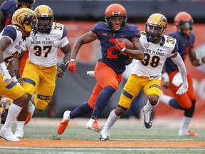 Reggie Corbin of the Illinois Fighting Illini runs the ball during a 2018 game against the Kent State Golden Flashes at Memorial Stadium in Champaign, Ill.