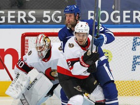Maple Leafs forward Joe Thornton gets in front of the Ottawa Senators net, making it rough for defenceman Artem Zub and goalie Matt Murray on Feb. 17, 2021.