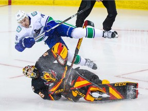 Calgary Flames goaltender Jacob Markstrom (25) and Vancouver Canucks left wing Tanner Pearson (70) collide during the second period at Scotiabank Saddledome.