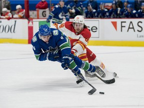 Feb 15, 2021; Vancouver, British Columbia, CAN; Calgary Flames forward Andrew Mangiapane (88) pursues Vancouver Canucks defenseman Quinn Hughes (43) in the first period at Rogers Arena. Mandatory Credit: Bob Frid-USA TODAY Sports
