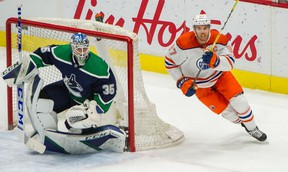VANCOUVER, BC - February 23, 2021  -  Edmonton Oilers Connor McDavid rounds the net behind Vancouver Canucks goalie Thatcher Demko in NHL action at Rogers Arena in Vancouver, BC, February 23, 2021.   Photo by Arlen Redekop / Vancouver Sun / The Province News (PNG) (story by  reporter) [PNG Merlin Archive]