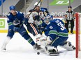 Thatcher Demko makes a save on Connor McDavid as the Vancouver Canucks host the Edmonton Oilers Saturday at Rogers Arena.