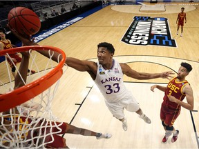 David McCormack #33 of the Kansas Jayhawks grabs a rebound against the USC Trojans in the second half of their second round game of the 2021 NCAA Men's Basketball Tournament at Hinkle Fieldhouse on March 22, 2021 in Indianapolis, Indiana.