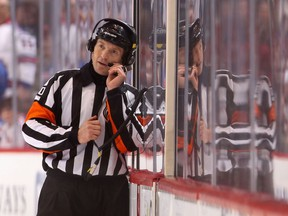 Referee Tim Peel manages a National Hockey League game earlier in his career, something he apparently took a little too far this week, prompting the league to stop assigning him games, several weeks short of his scheduled retirement.