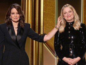 Hosts Tina Fey (left) and Amy Poehler are seen in this handout screen grab from the 78th Annual Golden Globe Awards in Beverly Hills February 28, 2021.