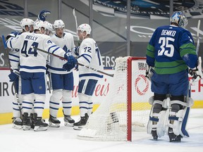 The Maple Leafs celebrate a goal against Thatcher Demko as the Canucks host Toronto at Rogers Arena on Saturday.