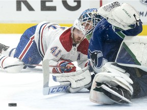 Montreal Canadiens right wing Paul Byron (41) fails to get a shot past Vancouver Canucks goaltender Thatcher Demko (35) during first period NHL action in Vancouver, Monday, March 8, 2021.