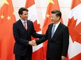 In this Aug. 31, 2016 file photo, Chinese President Xi Jinping shakes hands with Prime Minister Justin Trudeau ahead of their meeting at the Diaoyutai State Guesthouse in Beijing, China.