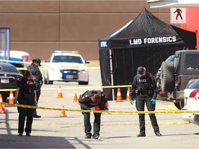 RCMP and the Integrated Homicide Investigation Team on the scene of a fatal shooting at the Langley Sportsplex on April 21, 2021.