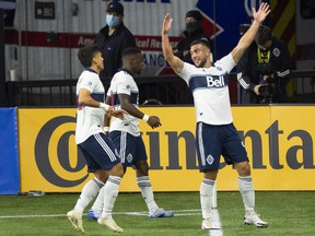 Marquee Whitecaps forward Lucas Cavallini (right, celebrating a goal he scored last season) will have his every on-field move for the Caps dissected this season on AM 730, as part of the MLS club's new deal to have their games broadcast by Corus Entertainment.