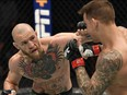 Jan 23, 2021; Abu Dhabi, United Arab Emirates; Conor McGregor of Ireland punches Dustin Poirier in a lightweight fight during the UFC 257 event inside Etihad Arena on UFC Fight Island.