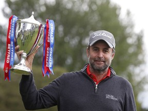Golf - European Tour - British Masters - The Belfry, Sutton Coldfield, Britain - May 15, 2021 England's Richard Bland celebrates winning the British Masters with the trophy.