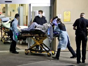 One of the survivors of Thursday night's triple shooting in Burnaby is wheeled into the emergency department at Royal Columbian Hospital.