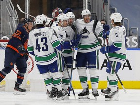 Vancouver Canucks forward Nils Höglander  celebrates a first period goal against the Edmonton Oilers at Rogers Place.