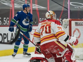 Canucks rookie Nils Höglander, the team's most exciting player as voted on by fans, looks ready to celebrate his first-period goal with teammates after beating Calgary Flames netminder Loius Domingue at Rogers Arena on Tuesday.