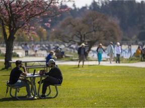 People soak up the sun in West Vancouver, April 2021.