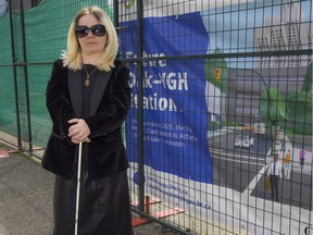 Laura Mackenrot, a member of Vancouver's persons with disabilities advisory committee, stands outside the construction site of the future Oak-VGH subway station in Vancouver.