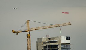 An airplane pulls a banner calling for the firing of Canucks GM Jim Benning in Vancouver on April 21, 2021.