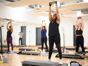 A group takes part in a high-energy barbell class at an indoor group exercise studio at Park Road Pools & Fitness on May 17, 2021 in London, England. When B.C. begins Step 2 of its Restart Plan on Tuesday, indoor high-intensity group exercises will once again be permitted, albeit with reduced capacity.