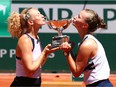 Katerina Siniakova and Barbora Krejcikova of The Czech Republic pose with the trophy after winning their Women's Doubles Final match against Bethanie Mattek-Sands of The United States and Iga Swiatek of Poland during Day Fifteen of the 2021 French Open at Roland Garros on June 13, 2021 in Paris, France.