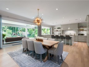 This North Vancouver home was designed for entertaining — eclipse doors open to an expansive covered patio complete with heaters and a built-in barbecue.