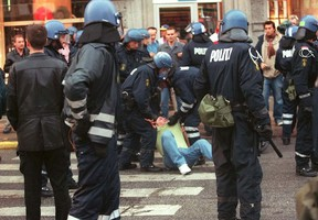 Police in Copenhagen, Denmark, subdue a man after the 2000 UEFA Cup final that saw riots erupt following Galatasaray's 4-1 win on penalties over Arsenal.