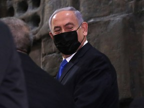 Israeli Prime Minister Benjamin Netenyahu arrives to the Knesset ahead of a parliamentary vote on a new government, in Jerusalem, on June 13, 2021.