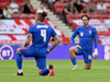 England defender Declan Rice, left, and striker Jack Grealish take a knee ahead of the international friendly football match between England and Romania in Middlesbrough, England on June 6, 2021.