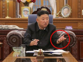 Kim Jong Un, wearing his IWC Schaffhausen Portofino wrist watch, presides at a meeting with senior officials from the Workers' Party of Korea Central Committee and Provincial Party Committees in Pyongyang, North Korea, in this undated photo released on June 8, 2021.