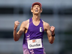 Evan Dunfee, of Richmond celebrates after finishing the 10,000 metre race walk event in a time of 38:39.72, setting a new Canadian record, during the Harry Jerome International Track Classic, in Burnaby on Saturday, June 12, 2021.