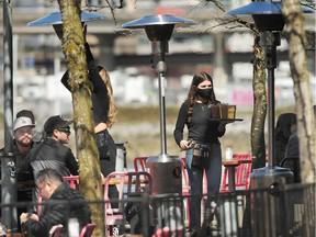 Patio patrons during COVID-19 restrictions in Vancouver, BC., on April 11, 2021.