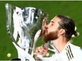 Real Madrid's Sergio Ramos celebrates with the trophy after winning La Liga.