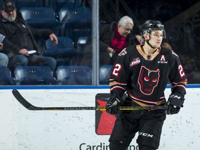 Vancouver Canucks defence prospect Jett Woo's play stalled in his final season of junior hockey with the Calgary Hitmen (above), but he bounced back with a solid first professional season last winter with the AHL's Utica Comets.