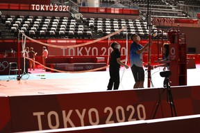 Officials prepare a volleyball net at the Ariake Arena ahead of the Tokyo 2020 Olympic Games on July 19, 2021 in Tokyo, Japan.