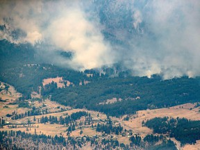 A wildfire burns in the mountains north of Lytton, B.C., on Thursday, July 1, 2021.