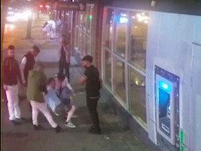This is a screen grab of a video. Vancouver police are looking to identify the men in the video after a group attacked a man on Granville Street earlier this month.