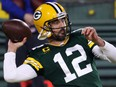 Pakcers quarterback Aaron Rodgers warms up prior to a game against the Panthers at Lambeau Field in Green Bay, Wis., Dec. 19, 2020.