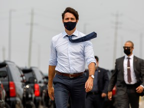 Canada's Prime Minister Justin Trudeau arrives to a press conference at a housing construction site in Brampton, Ontario, Canada July 19, 2021.