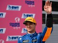 Lando Norris celebrates on the podium after the Austrian Grand Prix at the Red Bull Ring race track in Spielberg, Austria, on July 4, 2021.