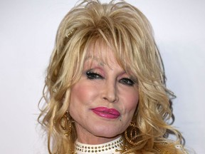 In this file photo taken on February 08, 2019 US singer-songwriter and 2019 MusiCares Person Of The Year Dolly Parton arrives for the 2019 MusiCares Person Of The Year gala at the Los Angeles Convention Center in Los Angeles.