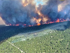 This handout photo courtesy of BC Wildfire Service shows the Sparks Lake wildfire, British Columbia, seen from the air on June 29, 2021.