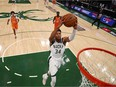 Milwaukee Bucks forward Giannis Antetokounmpo (34) drives to the basket against the Phoenix Suns during game four of the 2021 NBA Finals at Fiserv Forum.