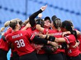 Team Canada celebrates after winning the bronze medal game in women's softball on Wednesday at the Tokyo Olympics.
